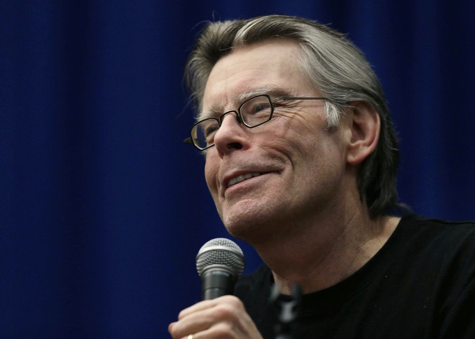 Novelist Stephen King speaks to creative writing students at the University of Massachusetts-Lowell in Lowell, Mass., Friday, Dec. 7, 2012. (AP Photo/Elise Amendola) ORG XMIT: MAEA102