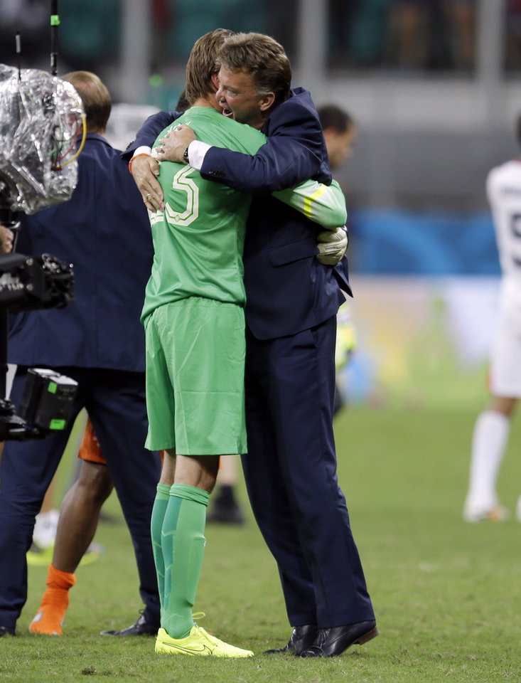 Photo - Netherlands' head coach Louis van Gaal hugs goalkeeper Tim Krul after the Netherlands defeated Costa Rica 4-3 in a penalty shootout after a 0-0 tie during the World Cup quarterfinal soccer match at the Arena Fonte Nova in Salvador, Brazil, Saturday, July 5, 2014. (AP Photo/Natacha Pisarenko)