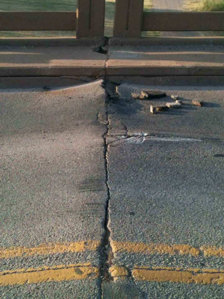 The bridge on State Highway 33 near downtown Guthrie is closed after the concrete buckled Wednesday. Photo provided by the state Transportation Department