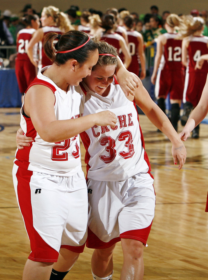 Photo - Cache's Nicole Vaden (23), left, puts her arm around Taylor Thompson (33) after the 4A girls semifinal game between Muldrow and Cache in the Oklahoma High School Basketball Championships at State Fair Arena in Oklahoma City, Friday, March 13, 2009. Cache won to advance to the championship game. PHOTO BY NATE BILLINGS, THE OKLAHOMAN