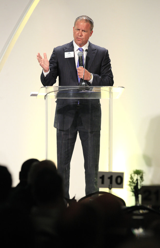 Photo -  Wayne Huizenga Jr., president of Huizenga Holdings, shares his personal story of faith Tuesday at the 31st annual Metro Prayer Breakfast at the Cox Convention Center in downtown Oklahoma City. Photo by Paul B. Southerland, The Oklahoman   PAUL B. SOUTHERLAND -