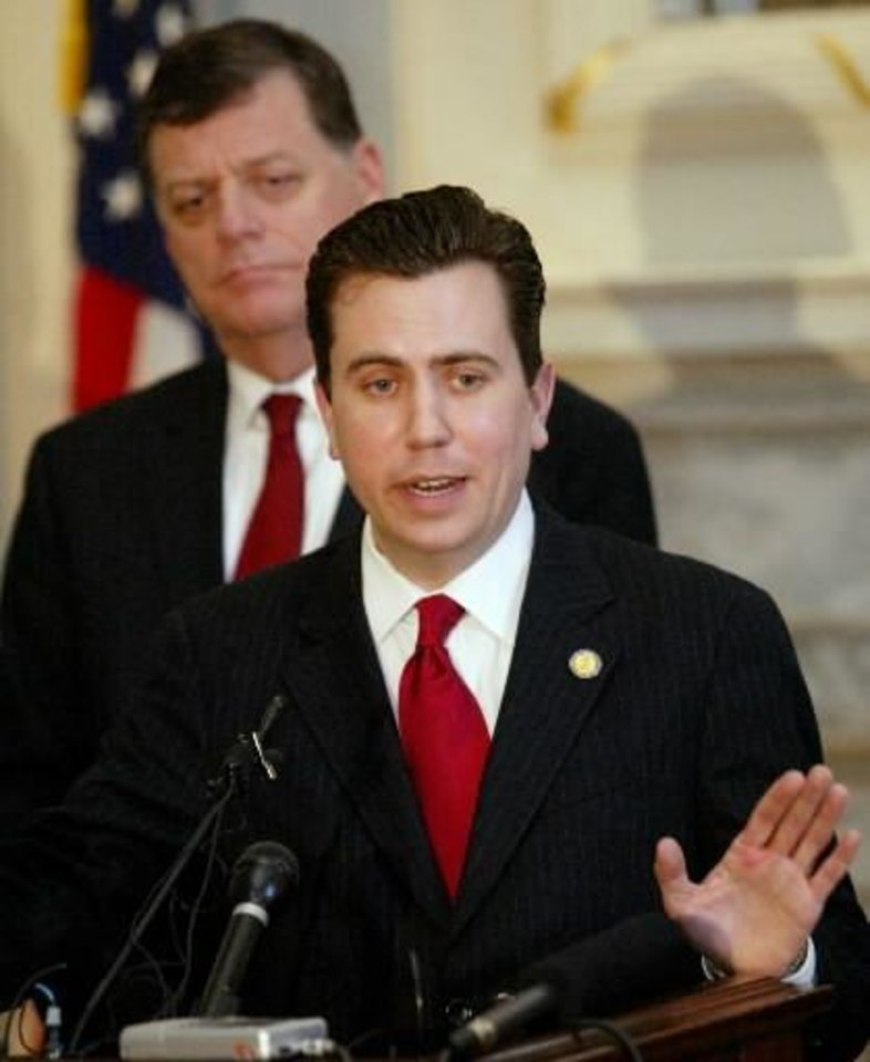 Photo -  In this Feb. 24, 2005, file photo, Rep.  Dan  Boren, right, D-Okla., and Rep. Tom Cole, R-Okla., answer questions at a news conference in Oklahoma City. Barack Obama, for all his attention and primary successes, does not go over so well in a fair number of Democratic lawmakers' home districts. So it seems there is little chance that some will endorse him for president.  Boren, the only congressional Democrat in Oklahoma, calls Obama