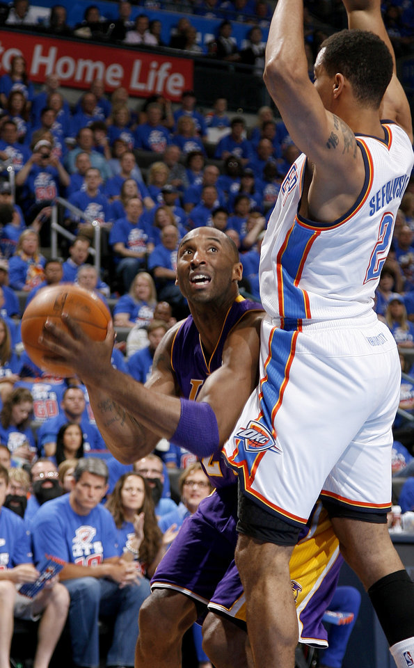 Photo - Los Angeles' Kobe Bryant (24) looks to shoot as Oklahoma City's Thabo Sefolosha (2) defends during Game 5 in the second round of the NBA playoffs between the Oklahoma City Thunder and the L.A. Lakers at Chesapeake Energy Arena in Oklahoma City, Monday, May 21, 2012. Photo by Bryan Terry, The Oklahoman