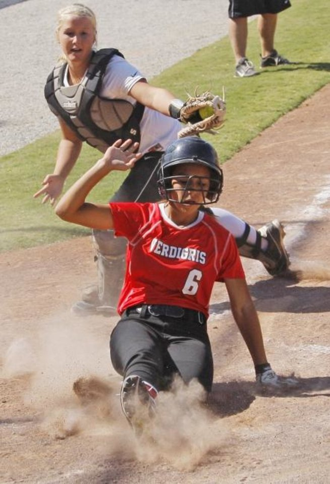 Photo -  Washington catcher Jacie Stephens attempts to tag a Verdigris baserunner during the 2011 fastpitch softball state tournament. Stephens, an All-State catcher who played at Emporia State in Kansas, died over the summer shortly after giving birth to her child, Jaxon. [The Oklahoman Archives]