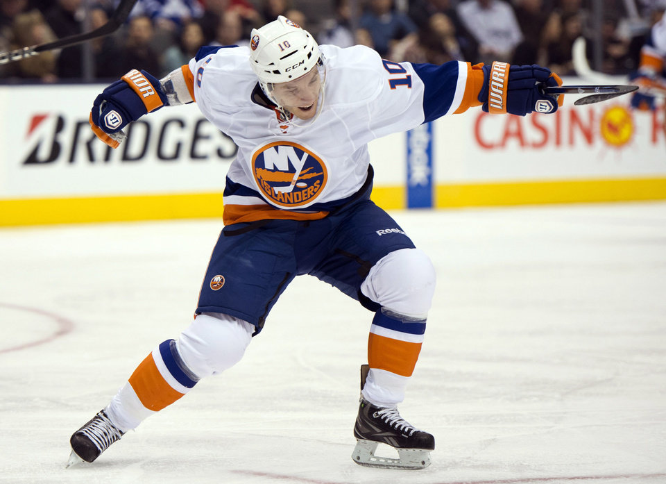 Photo - New York Islanders center Keith Aucoin celebrates his goal against the Toronto Maple Leafs during the third period of their NHL hockey game, Thursday, Jan. 24, 2013, in Toronto. The Islanders won 7-4. (AP Photo/The Canadian Press, Frank Gunn)