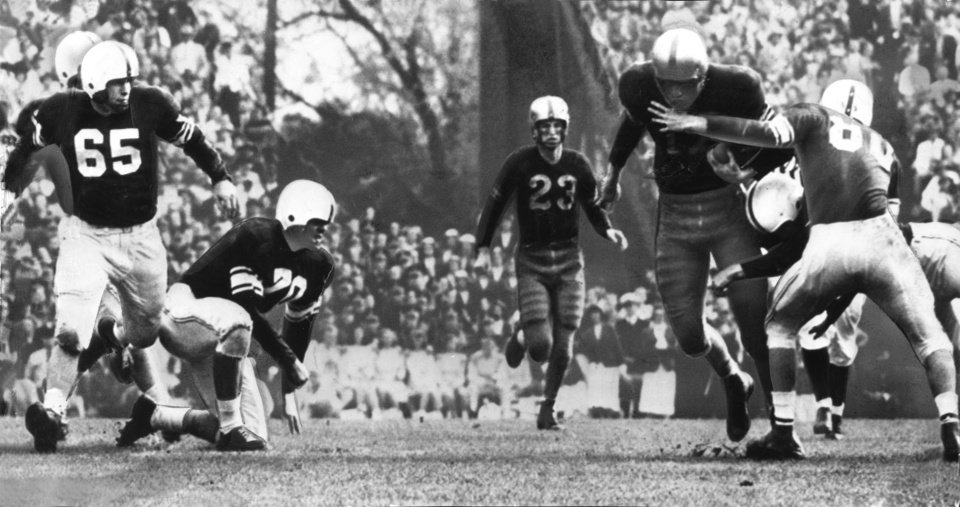 Photo - Elbert Van Buren (17), LSU fullback, gains three yards on a handoff from Charley Pevey (23).  He drags along Bobby Goad (80) as Norman McNabb (65) makes the tackle. The University of Oklahoma Sooners downed the Louisiana State University Tigers 35-0 in the 1950 Sugar Bowl in New Orleans. OKLAHOMAN ARCHIVE PHOTO