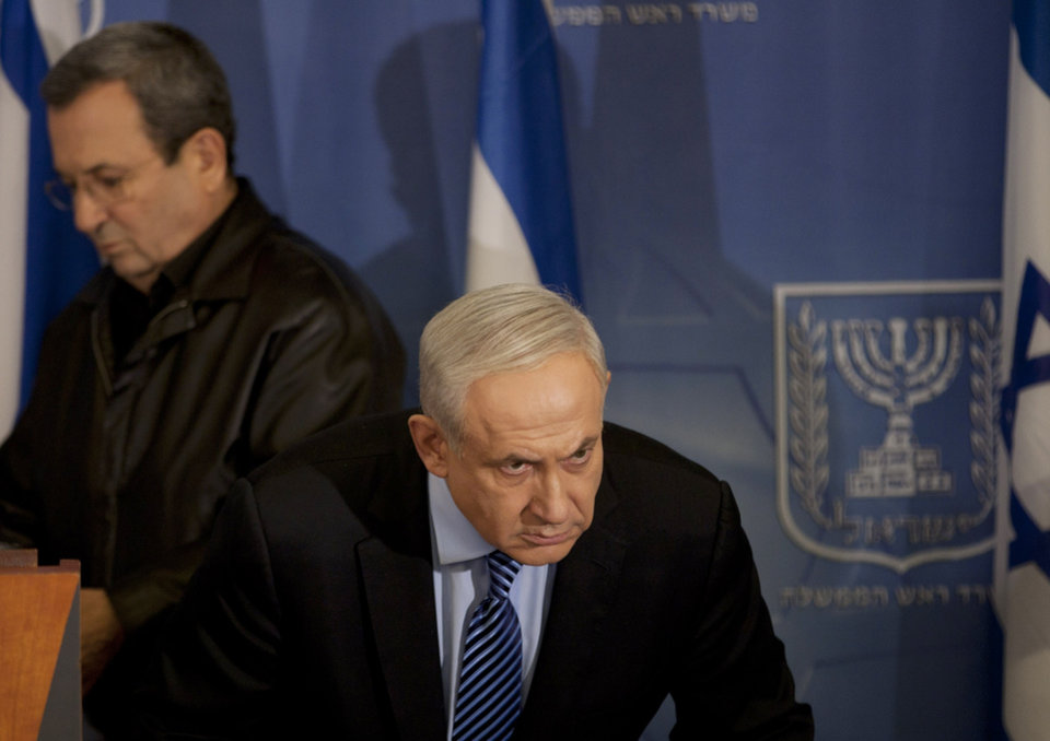 "Israel's Prime Minister Benjamin Netanyahu looks on as Israel's Defense Minister Ehud Barak, left, goes to deliver a statement to the media at Hakirya a military base in Tel Aviv, Israel, Wednesday, Nov. 14, 2012. Israel's prime minister says the military is prepared to broaden its operation against Hamas targets in Gaza. Benjamin Netanyahu says Israel cannot tolerate continued rocket attacks against its citizens. In his first comments since Israel killed the commander of the Hamas military wing, Netanyahu said Wednesday that Israel is ""prepared to expand the operation"". (AP Photo/Ariel Schalit)"