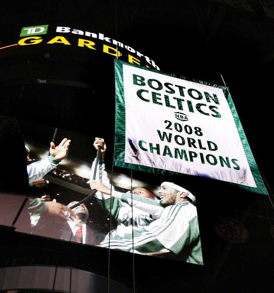 Photo - The Celtics raised their 17th NBA championship banner to the rafters.AP photo