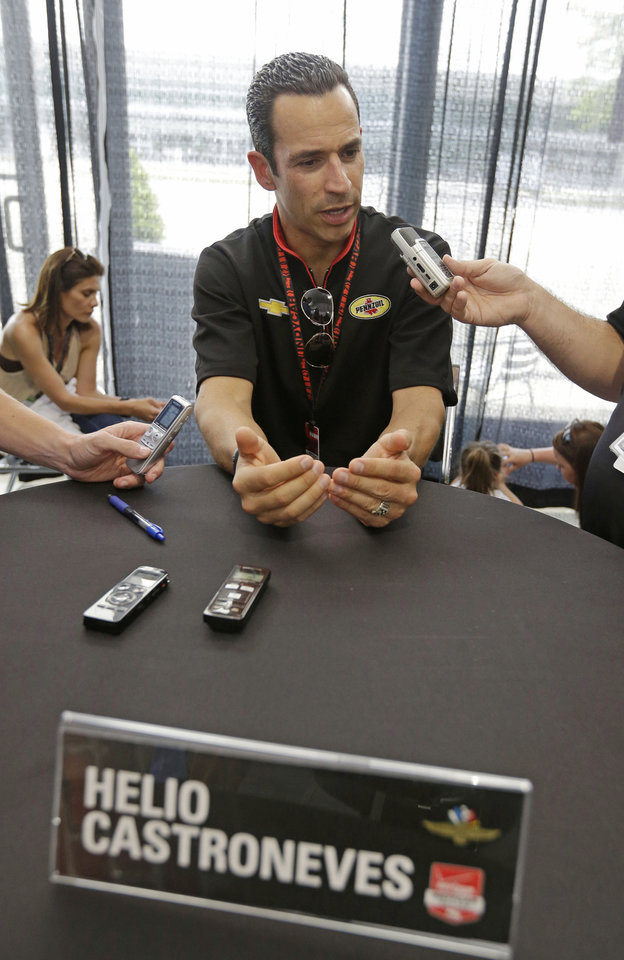Photo - Helio Castroneves, of Brazil, responds to a question during media interview for the Indianapolis 500 IndyCar auto race at the Indianapolis Motor Speedway in Indianapolis, Thursday, May 22, 2014. (AP Photo/Darron Cummings)