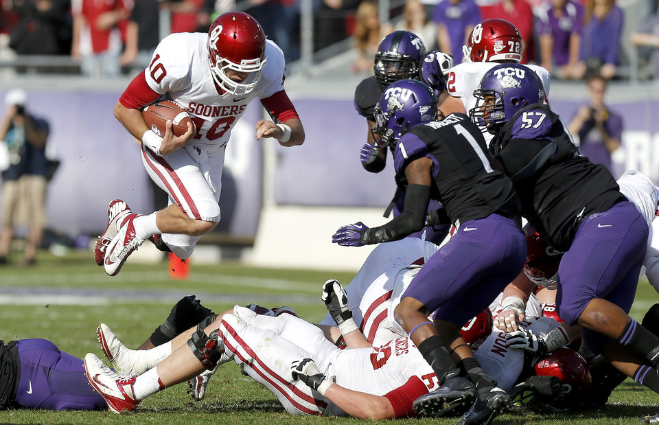 Photo - Oklahoma's Blake Bell (10) leaps for a first during a college football game between the University of Oklahoma Sooners (OU) and the Texas Christian University Horned Frogs (TCU) at Amon G. Carter Stadium in Fort Worth, Texas, Saturday, Dec. 1, 2012. Oklahoma won 24-17. Photo by Bryan Terry, The Oklahoman