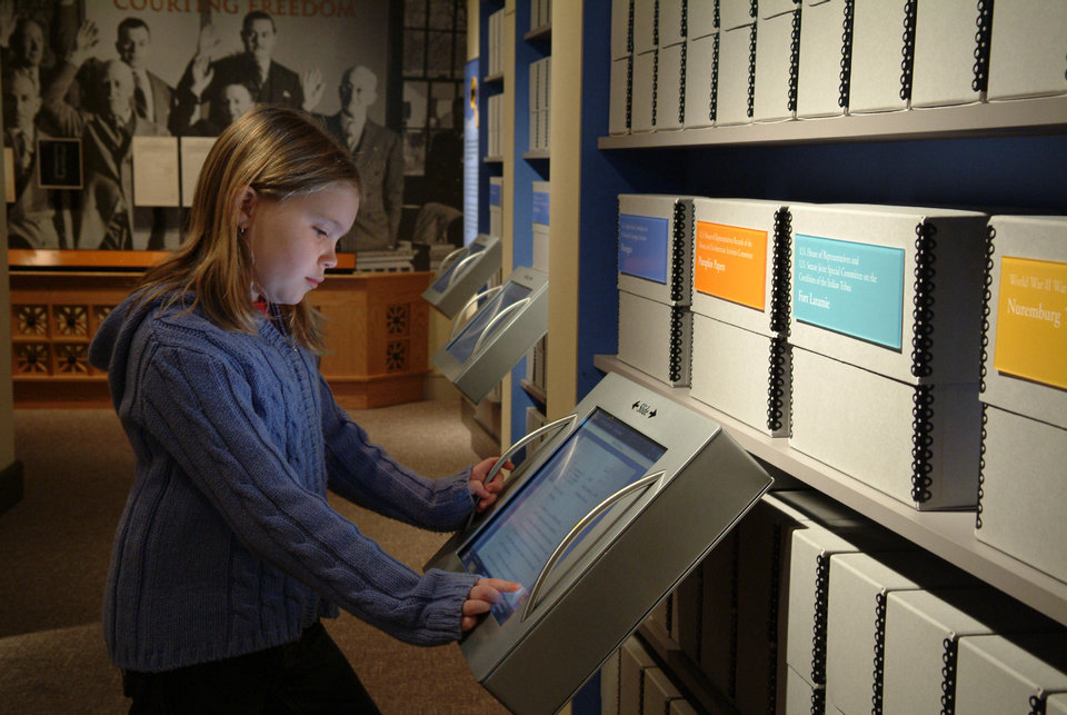 Photo - A child explores the interactive records in the Public Vault at the National Archives, a permanent exhibit that opened in 2004. PHOTO PROVIDED.
