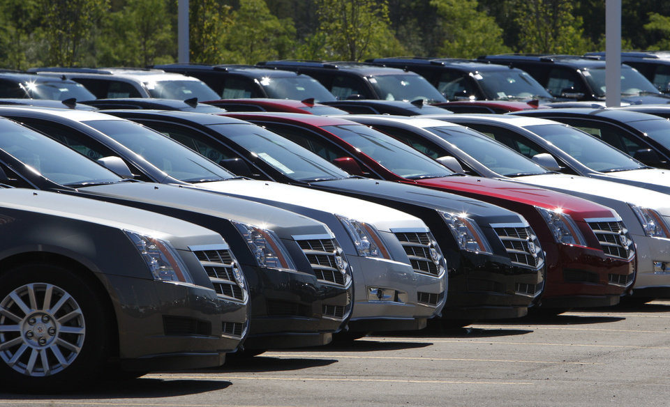 Photo -  This July 14, 2010, file photo shows Cadillac CTS vehicles being displayed outside the LaFountaine Cadillac in Highland Township, Mich. AP Photo   Carlos Osorio -