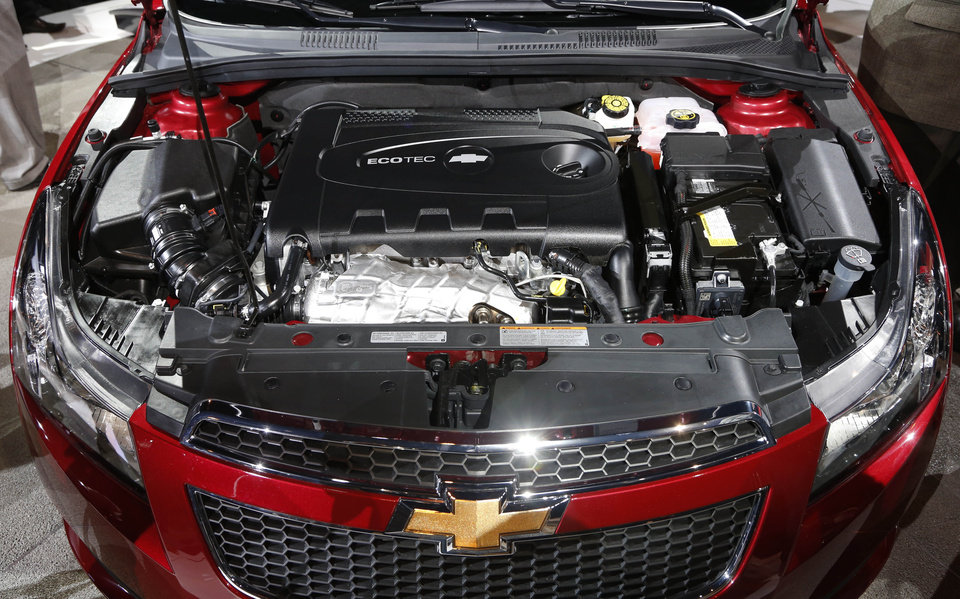 Photo - The 2014 Chevrolet Cruze Diesel engine is unveiled at the Chicago Auto Show Thursday, Feb. 7, 2013, in Chicago. (AP Photo/Charles Rex Arbogast)