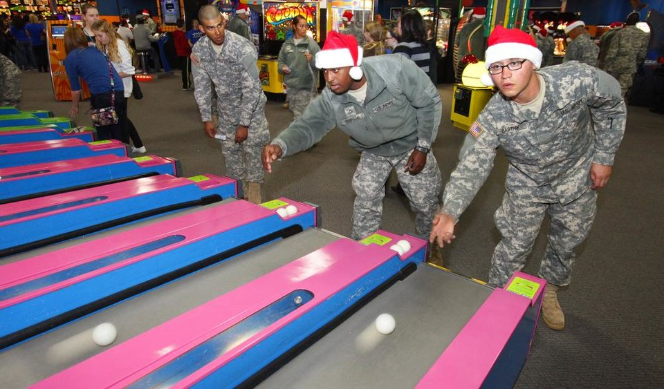 New recruits Pvt Carlos Netzahoalt and Tracy Simpson play ski ball during a lunch stop at Gatti Town during Soldiers Day Out, Friday, December 21, 2012. Edmond/North OKC Blue Star Mothers will be taking the soldiers who can\'t go home for Christmas around the metro for a day of fun. Photo By David McDaniel/The Oklahoman