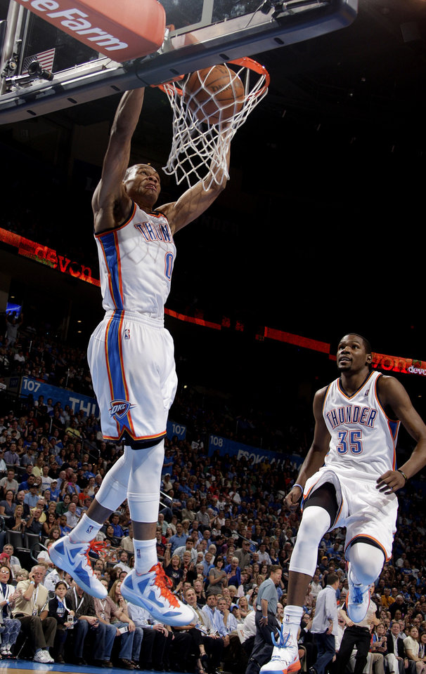 OKC�s Russell Westbrook, left, dunks the ball as Kevin Durant celebrates duirng a win against the Kings on Tuesday. Photo by Sarah Phipps, The Oklahoman