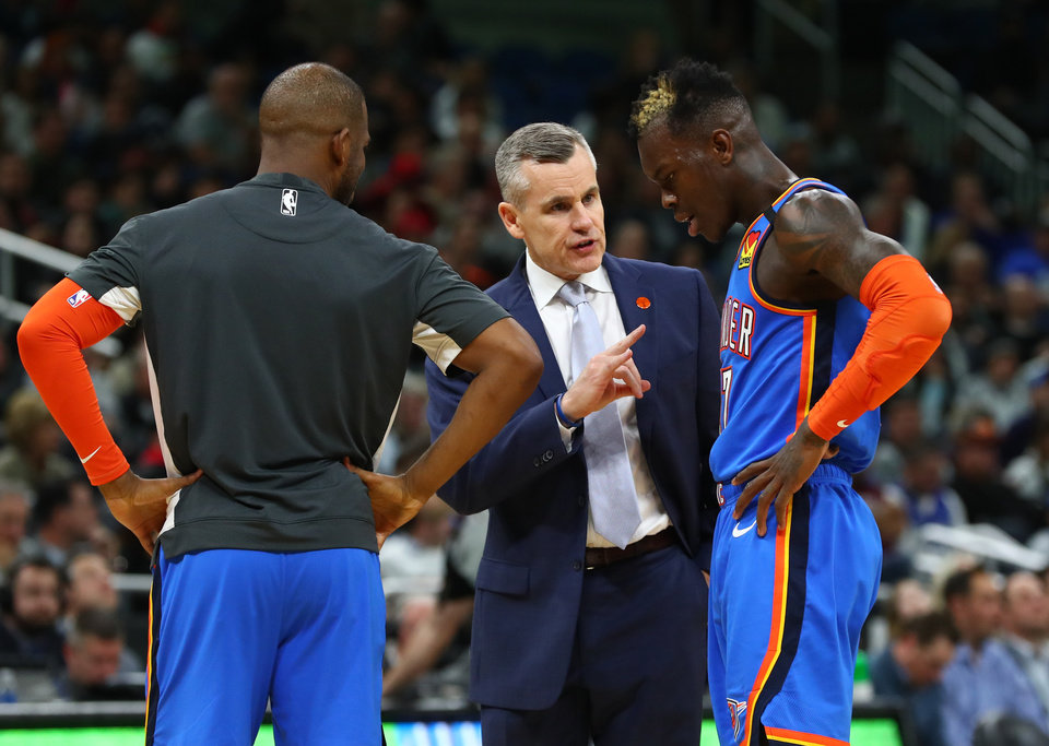 Photo - Jan 22, 2020; Orlando, Florida, USA; Oklahoma City Thunder head coach Billy Donovan talks with guard Dennis Schroder (17) and guard Chris Paul (3) against the Orlando Magic during the second half at Amway Center.  [Kim Klement/USA TODAY Sports]