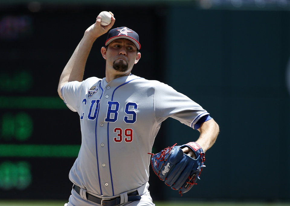 Photo - Chicago Cubs starting pitcher Jason Hammel (39) throws during the third inning of a baseball game against the Washington Nationals at Nationals Park, Friday, July 4, 2014, in Washington. (AP Photo/Alex Brandon)