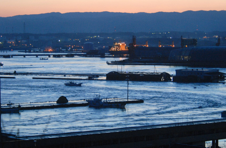Photo - Tsunami swirls inside a port in Iwaki, Fukushima Prefecture (state) after Japan was struck by a strong earthquake off its northeastern coast Friday, March 11, 2011. (AP Photo/Kyodo News) JAPAN OUT, MANDATORY CREDIT, FOR COMMERCIAL USE ONLY IN NORTH AMERICA ORG XMIT: TOK833
