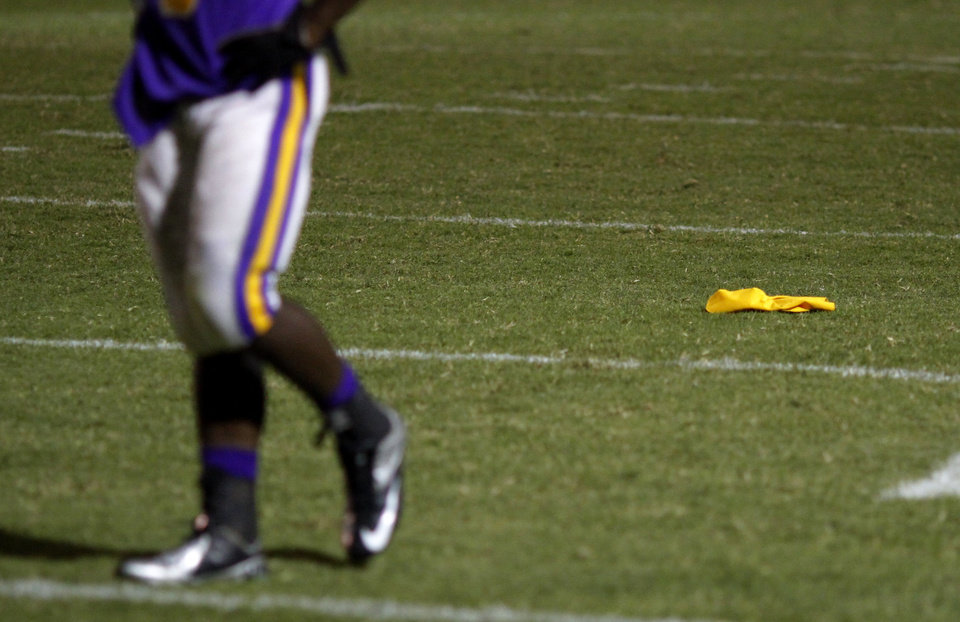 A NWC player walks back to the line after a flag was dropped nullifying a touchdown at the Northwest Classen vs. Western Heights high school football game at Taft Stadium Thursday, September 20, 2012. Photo by Doug Hoke, The Oklahoman