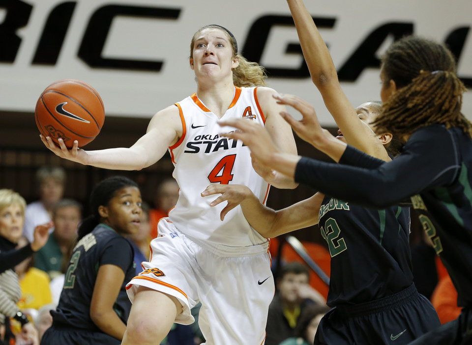 Oklahoma State's Liz Donohoe (4) goes to the basket beside Baylor's Alexis Prince (12) during a women's college basketball game between Oklahoma State University and Baylor at Gallagher-Iba Arena in Stillwater, Okla., Saturday, Feb. 2, 2013. Photo by Bryan Terry, The Oklahoman