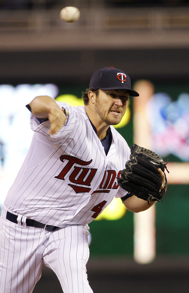 Photo - Minnesota Twins pitcher Phil Hughes delivers to the Toronto Blue Jays during the third inning of a baseball game in Minneapolis, Tuesday, April 15, 2014.  (AP Photo/Ann Heisenfelt)