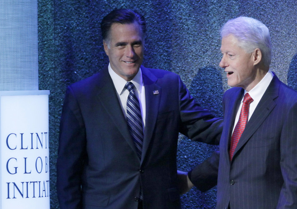 Photo -   Republican presidential candidate, former Massachusetts Gov. Mitt Romney is introduced by former President Bill Clinton at the Clinton Global Initiative, Tuesday, Sept. 25, 2012, in New York. (AP Photo/Mark Lennihan)