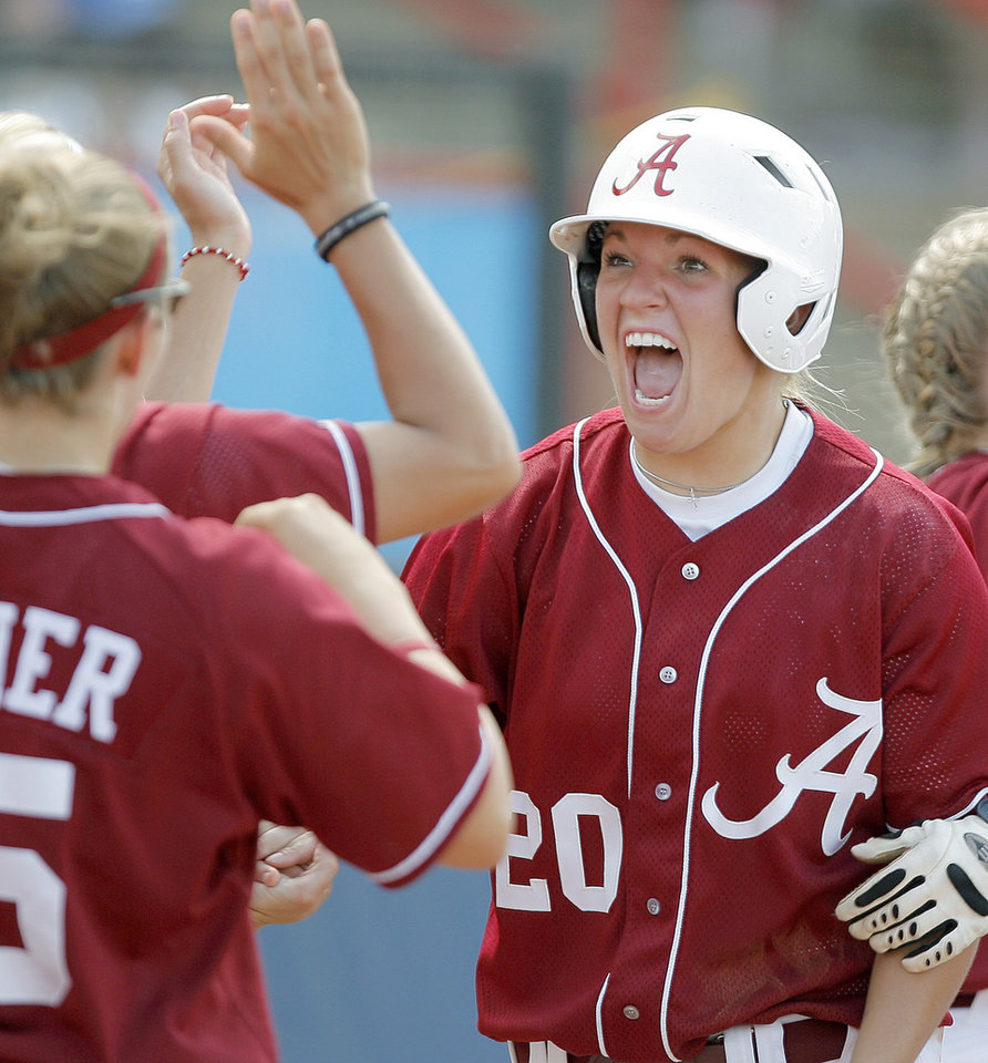 Photo - Alabama's Whitney Larson celebrates after scoring in the sixth inning of the Women's College World Series game between Alabama and Arizona at ASA Hall of Fame Stadium in Oklahoma City, Saturday, May 31, 2008. BY BRYAN TERRY, THE OKLAHOMAN