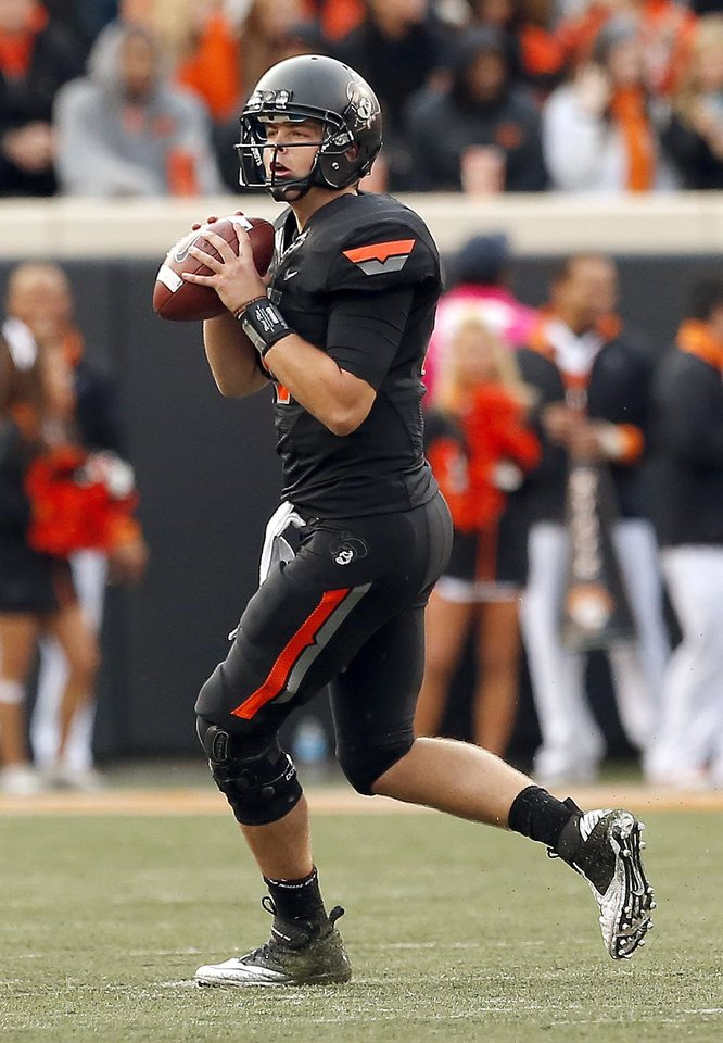 Photo - Oklahoma State's Wes Lunt (11) looks to pass the ball during a college football game between Oklahoma State University (OSU) and Texas Christian University (TCU) at Boone Pickens Stadium in Stillwater, Okla., Saturday, Oct. 27, 2012. Photo by Sarah Phipps, The Oklahoman