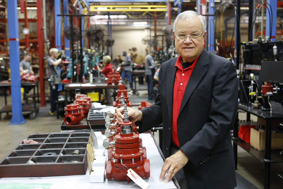 KIMRAY CEO Tom Hill poses with gas regulators in Oklahoma City on Aug. 19, 2013. Photo By Steve Gooch, The Oklahoman <strong>Steve Gooch</strong>