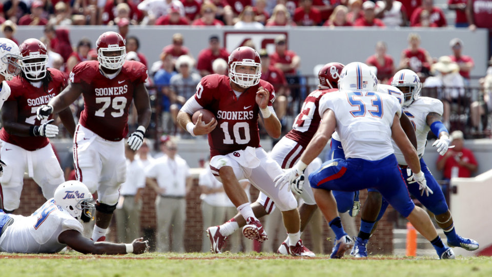 Photo - Oklahoma's Blake Bell (10) carries  the ball during the second half of a college football game between the University of Oklahoma Sooners (OU) and the Tulsa Golden Hurricane (TU) at Gaylord Family-Oklahoma Memorial Stadium in Norman, Okla., on Saturday, Sept. 14, 2013. Photo by Steve Sisney, The Oklahoman
