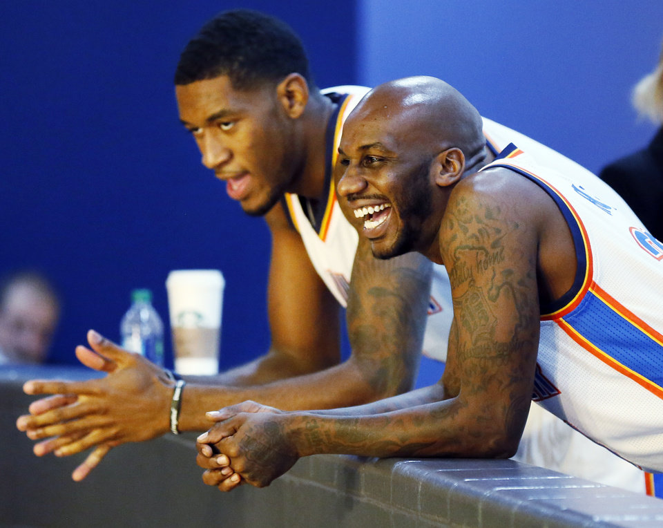 Walker Russell, right, laughs with Perry Jones while waiting for their next interview during media day for the Oklahoma City Thunder NBA basketball team at the Thunder Events Center in Oklahoma City, Monday, Oct. 1, 2012. Photo by Nate Billings, The Oklahoman