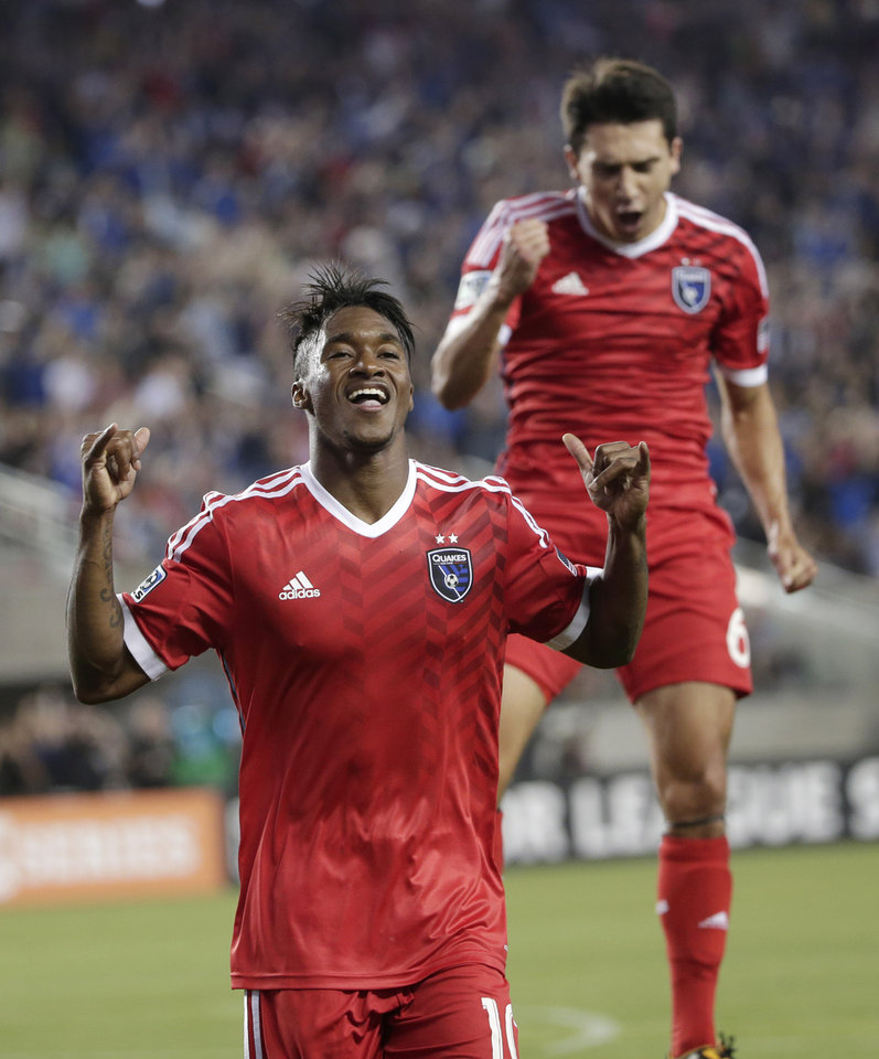 Photo - San Jose Earthquakes' Yannick Djalo, left, celebrates his goal with teammate Shea Salinas during the first half of an MLS soccer match against the Seattle Sounders on Saturday, Aug. 2, 2014, in Santa Clara, Calif. (AP Photo/Marcio Jose Sanchez)