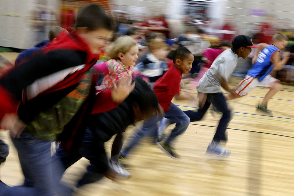 A group of children run after during a wellness fair at Jefferson Elementary School in Norman, Okla., Thursday, Jan. 24. 2013. Photo by Bryan Terry, The Oklahoman