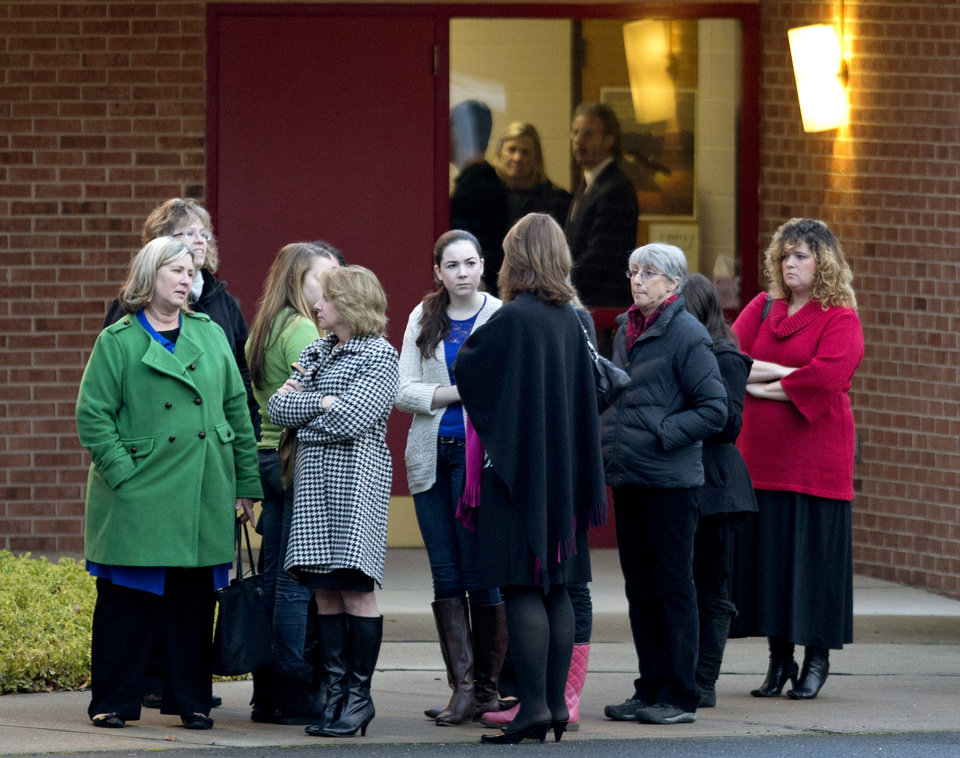 Photo - Mourners gather for the wake of Sandy Hook Elementary School shooting victim Charlotte Helen Bacon, 6, at Christ the King Lutheran Church, Tuesday, Dec. 18, 2012, in Newtown, Conn. (AP Photo/David Goldman)