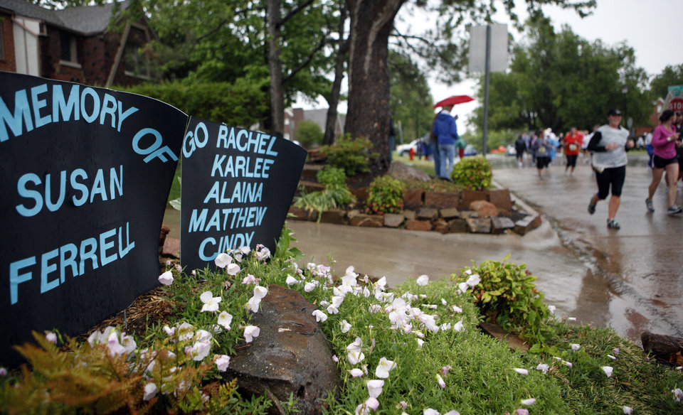 Photo - Signs are displayed along the marathon route at NW 42nd and N Shartel Ave during the Oklahoma City Memorial Marathon, Sunday, May 1, 2010, in Oklahoma City. Photo by Sarah Phipps, The Oklahoman