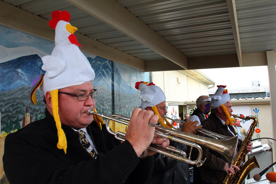 Photo - Mark Guinn of Yukon plays the chicken dance song on the trumpet during the 47th annual Czech Festival Saturday in Yukon. PHOTO BY HUGH SCOTT FOR THE OKLAHOMAN