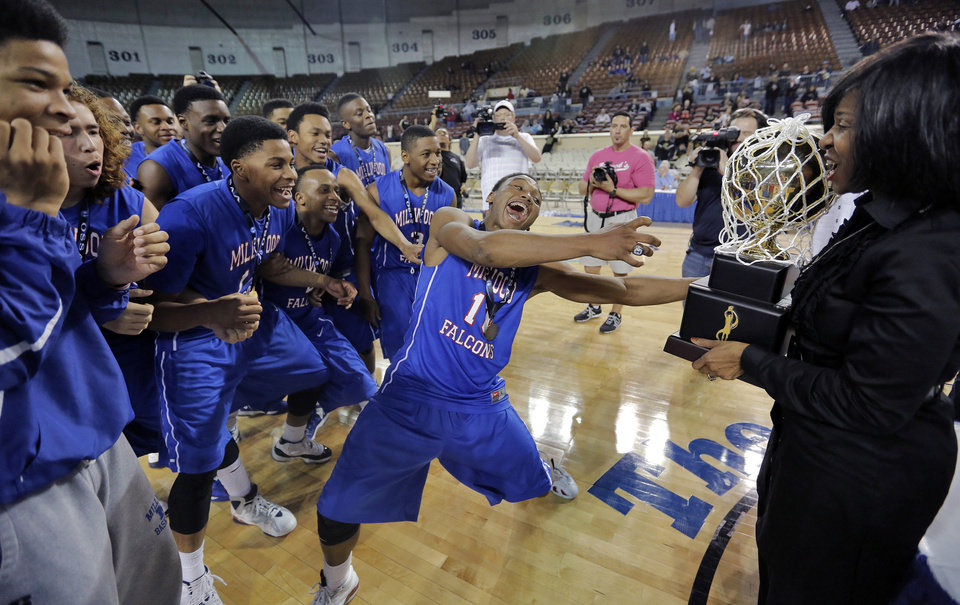 Photo - Millwood's Chris Crook (10) reaches for the gold ball trophy after the win over Okemah during the state high school basketball tournament Class 3A boys championship game between Millwood High School and Okemah High School at the State Fair Arena on Saturday, March 9, 2013, in Oklahoma City, Okla. Photo by Chris Landsberger, The Oklahoman