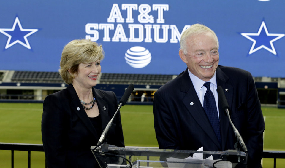 Photo - Dallas Cowboys owner Jerry Jones, right, and AT&T senior vice president Cathy Coughlin smile during news conference announcing the naming of the new AT&T Stadium and home of the Dallas Cowboys Thursday, July 25, 2013, in Arlington, Texas. The terms of the naming deal were not released.  (AP Photo/LM Otero)