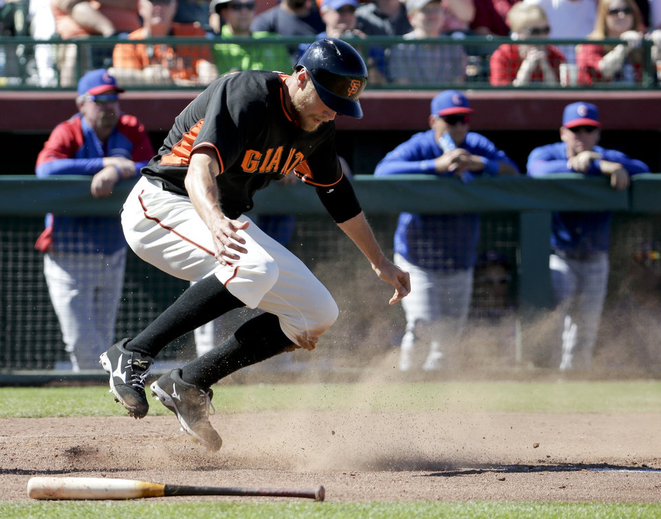 Photo - San Francisco Giants' Michael Morse celebrates after scoring on a two-run single by Pablo Sandoval during the fourth inning of a spring exhibition baseball game against the Chicago Cubs in Scottsdale, Ariz., Monday, March 10, 2014. (AP Photo/Chris Carlson)