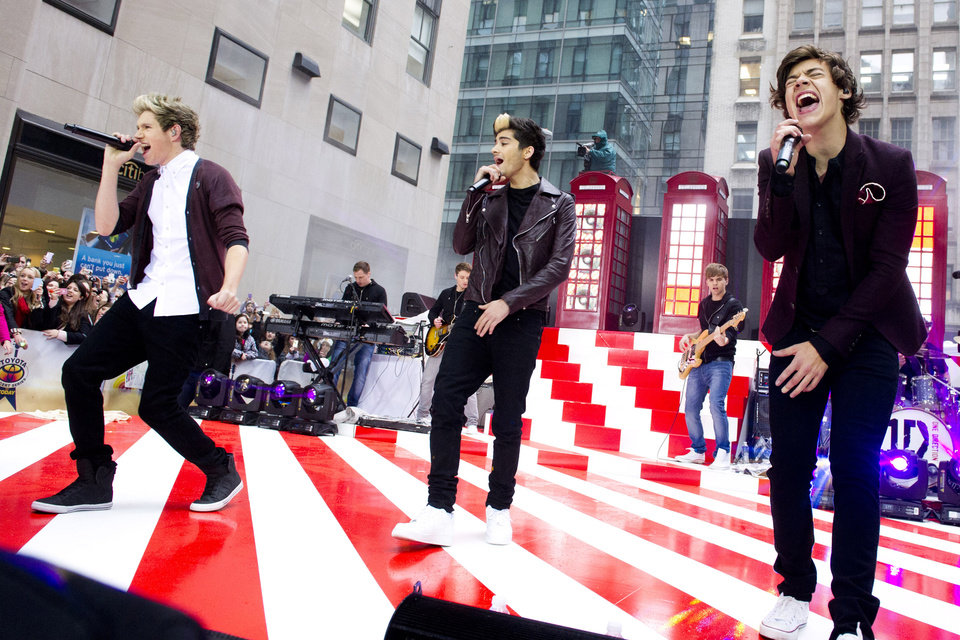 "One Direction members, from left, Niall Horan, Zayn Malik and Harry Styles perform on NBC's ""Today"" show on Tuesday, Nov. 13, 2012 in New York. (Photo by Charles Sykes/Invision/AP)"