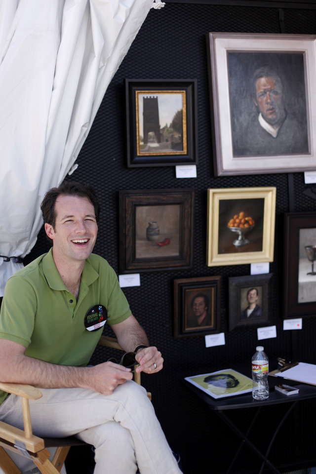 Photo - Michael DeVore at his booth during opening day of the Festival of the Arts in downtown Oklahoma City TUesday, April 24, 2012. Photo by Doug Hoke, The Oklahoman
