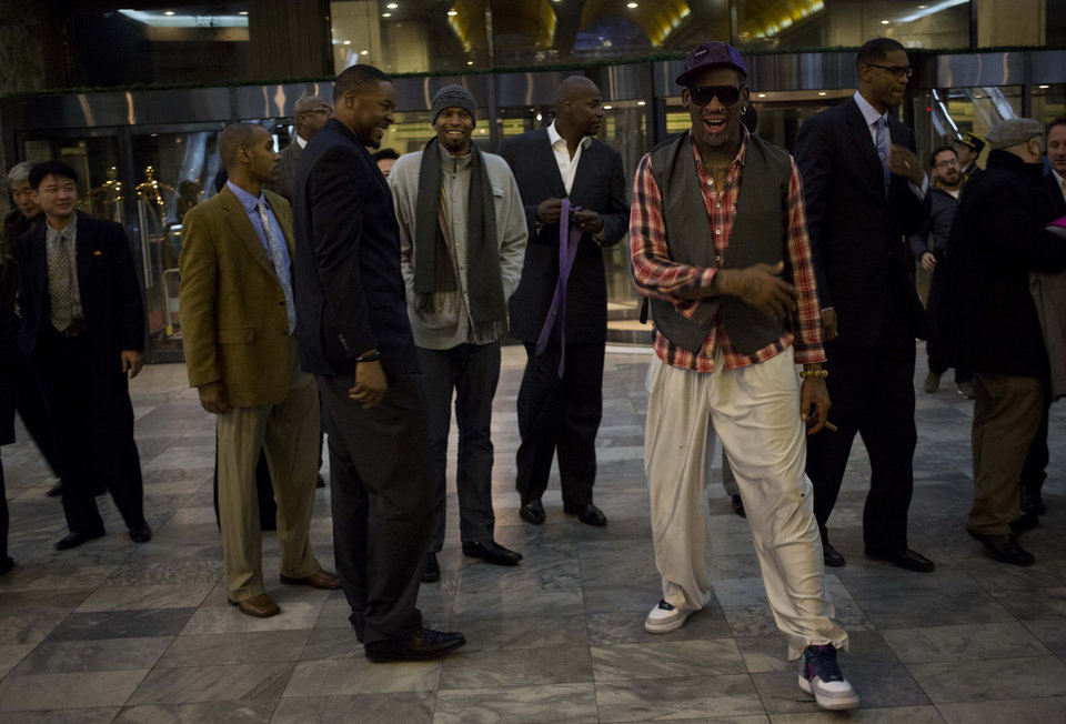 Photo - Former NBA basketball star Dennis Rodman, foreground right,  and fellow U.S. basketball players arrive at a hotel in Pyongyang, North Korea after returning from an official dinner on Monday, Jan. 6, 2014. Rodman arrived in the North Korean capital with a squad of former basketball stars in what he calls