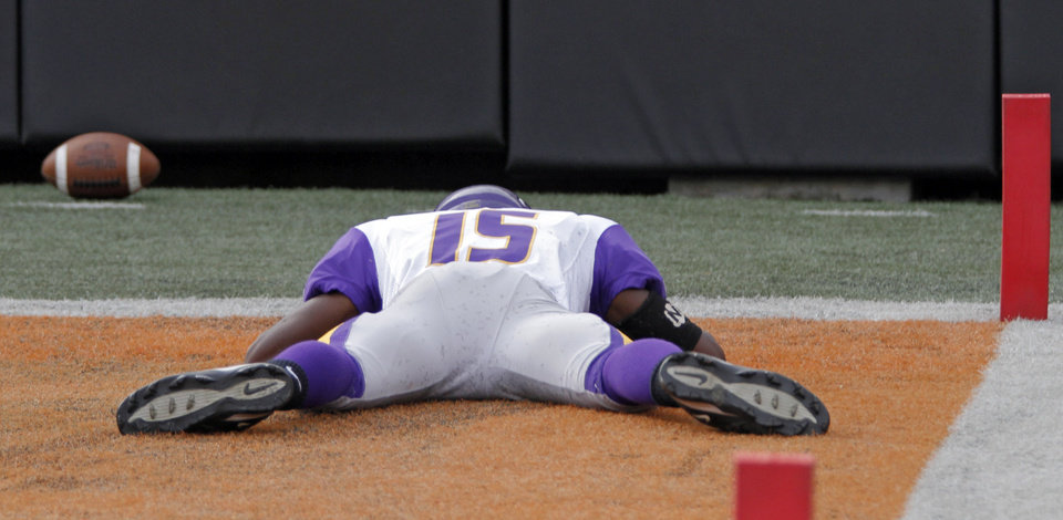Anadarko's Kellum Gray (15) stays face down on the field after dropping a potential touchdown in the final second of the game during the Class 4A Oklahoma state championship football game between Anadarko and Clinton at Boone Pickens Stadium on Saturday, Dec. 1, 2012, in Stillwater, Okla.   Photo by Chris Landsberger, The Oklahoman