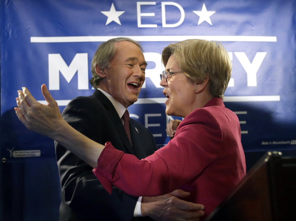 Photo - U.S. Senate candidate Ed Markey reacts with U.S. Sen. Elizabeth Warren, D-Mass., in Boston, Tuesday, April 30, 2013 as he celebrates winning the Democratic primary for the special U.S. Senate election. (AP Photo/Elise Amendola)