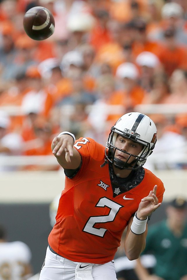 Photo - Oklahoma State's Mason Rudolph (2) throws the ball in the first quarter during the college football game between the Oklahoma State Cowboys (OSU) and the Southeastern Louisiana Lions at Boone Pickens Stadium in Stillwater, Okla., Saturday, Sept. 12, 2015. Photo by Sarah Phipps, The Oklahoman