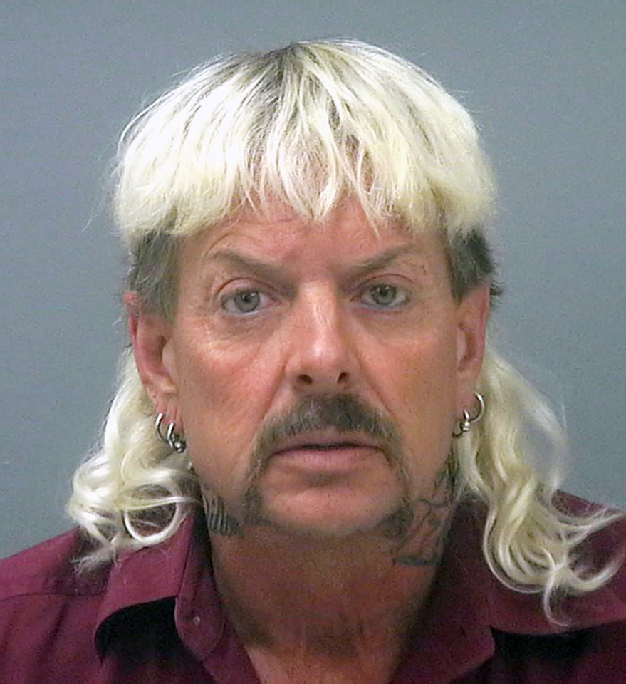 "Photo - FILE - This file photo provided by the Santa Rose County Jail in Milton, Fla., shows Joseph Maldonado-Passage. Prosecutors say Maldonado-Passage, also known as ""Joe Exotic, tried to arrange the killing of Carole Baskin, the founder of Big Cat Rescue. Lurors were shown a Facebook video Tuesday, March 26, 2019,  that depicts Maldonado-Passage shooting a blow-up ""Carole"" doll in the head. Other videos show him pretending to dig a grave for Baskin and threatening to mail her rattlesnakes. (Santa Rosa County Jail via AP, File)"