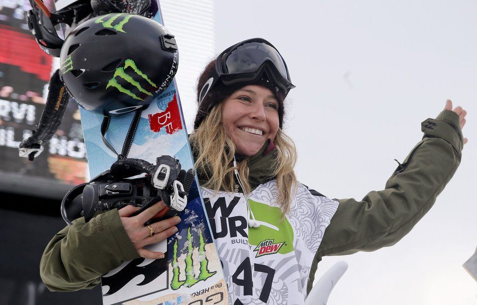 Jamie Anderson waves from the podium after winning the women's slopestyle snowboarding final at the Dew Tour iON Mountain Championships, Friday, Dec. 13, 2013, in Breckenridge, Colo. (AP Photo/Julie Jacobson)