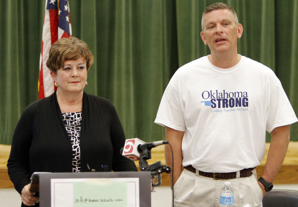 Photo - Susan Pierce, superintendent of Moore Public Schools, and Robert Romines, the incoming superintendent, dispel a rumor that a teacher was fired for praying with her students during the May 20 tornado. Photo by KT King, The Oklahoman  KT King - The Oklahoman
