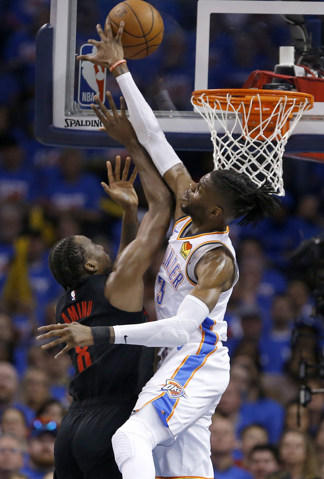 Photo - Oklahoma City's Nerlens Noel (3) blocks the shot of Portland's Al-Farouq Aminu (8) during Game 4 in the first round of the NBA playoffs between the Portland Trail Blazers and the Oklahoma City Thunder at Chesapeake Energy Arena in Oklahoma City, Sunday, April 21, 2019. Portland won 111-98. Photo by Sarah Phipps, The Oklahoman