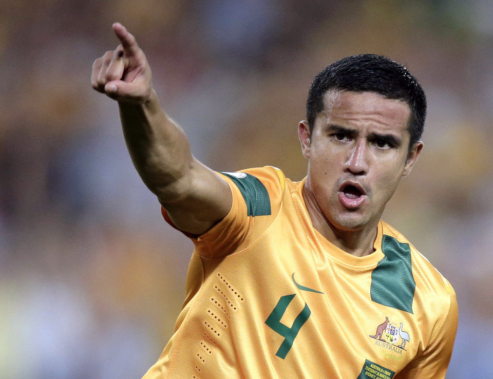 Photo - FILE - In this March 26, 2013 file photo, Australia's Tim Cahill reacts to scoring against Oman during their World Cup Asian qualifying soccer match at the Sydney Olympic Stadium in Sydney, Australia. Crystal Palace midfielder Mile Jedinak will lead Australia at the World Cup after getting the nod over Tim Cahill to replace long-term captain Lucas Neill. Australia coach Ange Postecoglou announced the decision Wednesday, May 21, 2014, five days ahead of the Socceroos' last friendly on home soil before the squad leaves for Brazil. (AP Photo/Rick Rycroft, File)